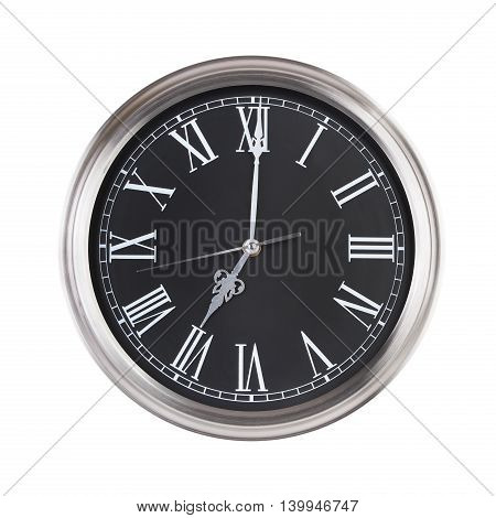 Round big clock shows exactly seven o'clock
