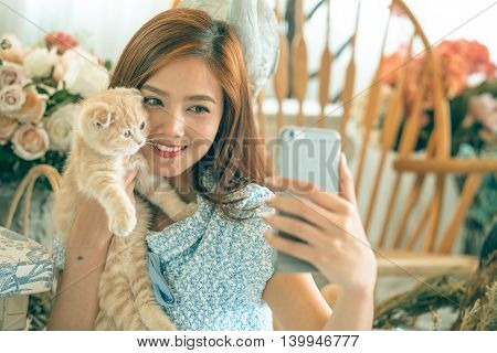 Selfie Cat With A Cute Little Girl .