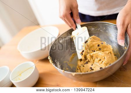 Woman mixing the drough to make chocolate cookies