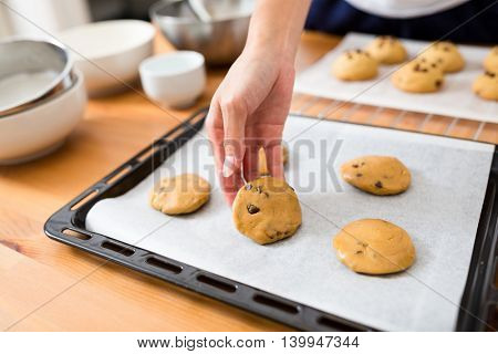 Woman making the chocolate cookies