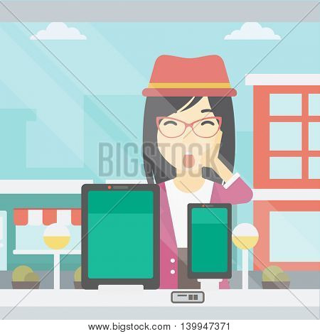 Astonished woman looking at digital tablet and smartphone through shop window. An asian young woman with open mouth looking at tablet and phone. Vector flat design illustration. Square layout.