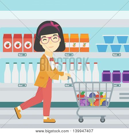 An asian young woman pushing a supermarket cart with some goods in it. Customer shopping at supermarket with cart full with groceries. Vector flat design illustration. Square layout.
