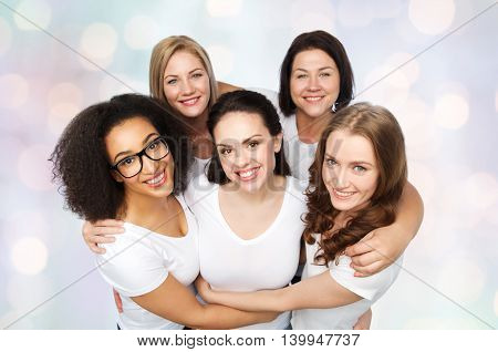 friendship, diverse, body positive and people concept - group of happy different size women in white t-shirts over holidays lights background
