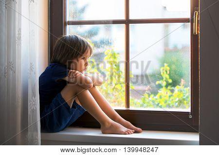 Sad Child, Boy, Sitting On A Window Shield