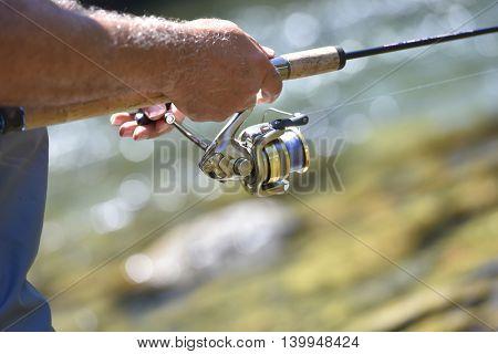 Closeup of fishing reel on rod