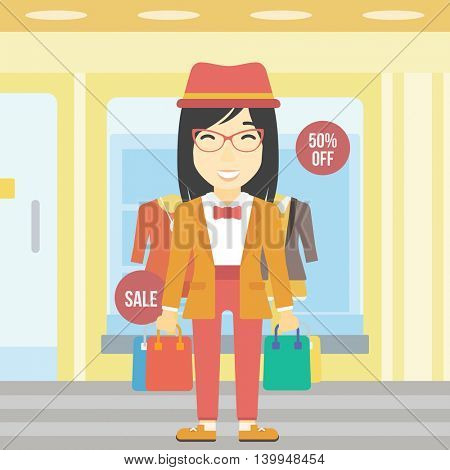An asian woman holding shopping bags on the background of boutique window with dressed mannequins. Happy young woman carrying shopping bags. Vector flat design illustration. Square layout.