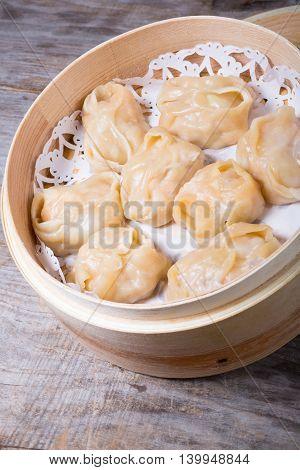 Chinese prepared dim sum in bamboo steamer box