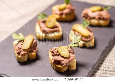 Appetizer with pate served on a Slate plate