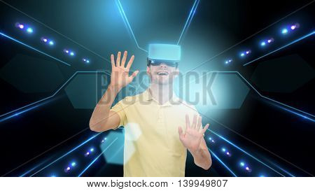 3d technology, virtual reality, cyberspace and people concept - happy young man with virtual reality headset or 3d glasses touching screen projection over black background and laser light