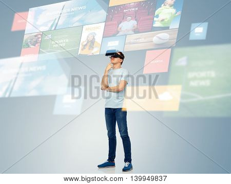 3d technology, virtual reality, entertainment, cyberspace and people concept - happy young man with virtual reality headset or 3d glasses thinking and looking at screen with internet news