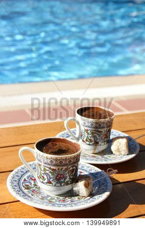 Traditional Turkish coffee is hot around the pool.