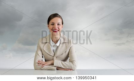 Businesswoman sitting at desk . Mixed media