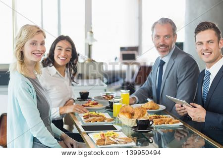 Portrait of business people having meal in restaurant