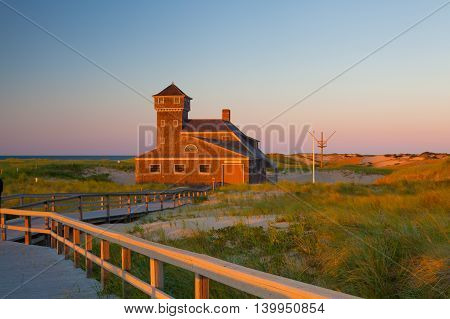 Beach house at Cape Cod at sunset Massachusetts USA.