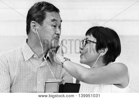 Senior Couple Mobile Earphones Concept