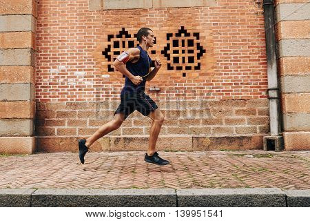 Side view of running sportsman: healthy lifestyle