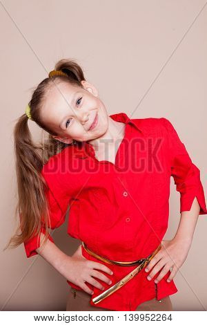 little casual girl with pigtails smiling in studio