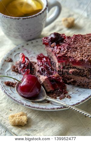 Chocolate cake with cherry and lemon tea