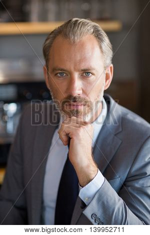 Portrait of confident businessman in café