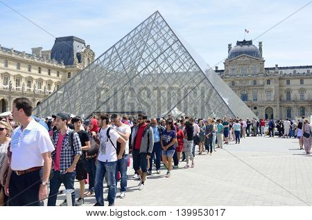 PARIS FRANCE 7 JUNE 2015: Large queue outside louvre Paris