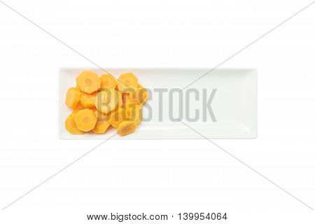 Closeup fresh pile of cut carrot on ceramic square plate isolated on white background prepare for cook concept with copy space and clipping path