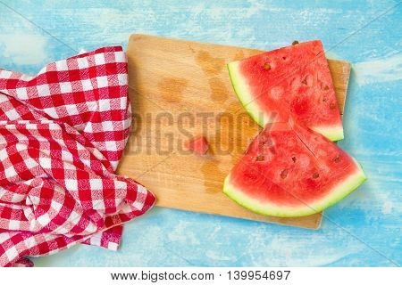 Watermelon slices on wooden board top view selective focus
