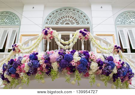 Decorated balcony with colorful beautiful flower tropical climate flora and architecture