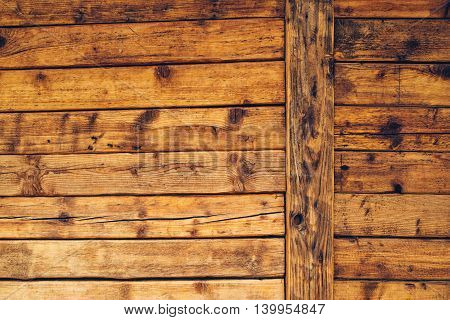 Wooden cabin wall surface of rustic wood planks