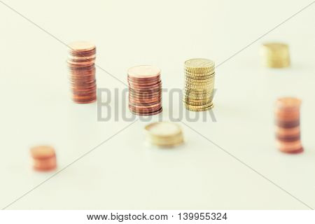 business and money saving concept - close up of coins columns