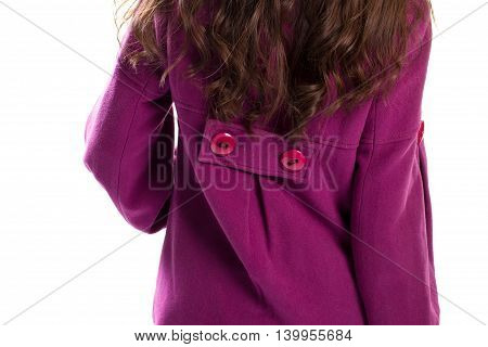 Back view of purple coat. Garment with buttons on back. New outerwear from autumn catalog. Model wears fleece jacket.