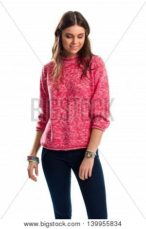 Lady in pink sweater smiling. Dark pants and colorful bracelets. Fashionable clothes for spring. New wrist accessories.