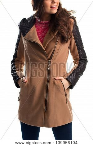 Lady in beige coat. Coat with diagonal zipper. Expensive garment from limited collection. Fleece and quilted leather.