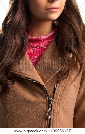 Beige coat with diagonal zipper. Pink collar of sweater. Clothes that keeps you warm. Comfort in any weather.
