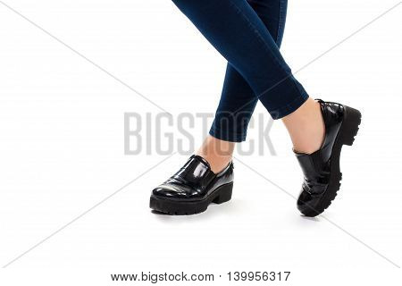 Woman's legs in black shoes. Dark navy pants and footwear. Brand new slip ons. Thick rubber sole.