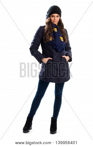 Woman in navy down jacket. Black ankle boots and scarf. New winter apparel. Outerwear with warm lining.