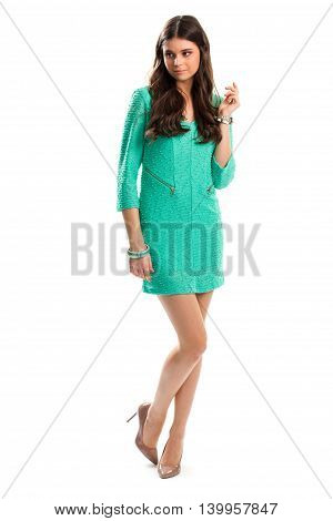 Woman in turquoise dress. Glossy heel shoes. Elegant summer outfit. Cotton dress with pockets.