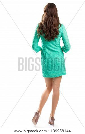 Woman in dress and heels. Back view of turquoise dress. First date outfit. Dress simply and attractively.