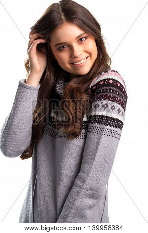 Woman is smiling widely. Gray pullover with print. Positive energy of smile. Kind and happy look.
