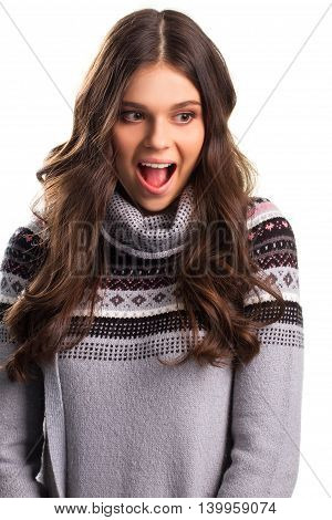 Excited woman on white background. Pattern on gray sweatshirt. Luck never runs out. So many interesting plans.
