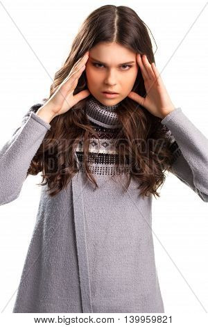 Lady touches head with fingers. Gray sweater with a pattern. Irritated and angry. Don't push on me.