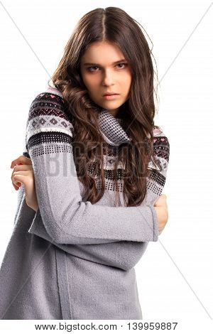 Woman in gray pullover. Lady with long brown hair. Alluring look of young model. Romance and temptation.