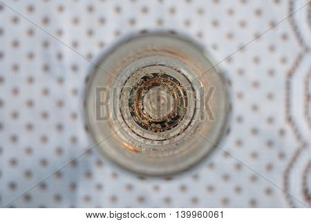 Gold engagement ring in a glass of champagne. Creative photography with champagne bubbles glittering in the sunlight