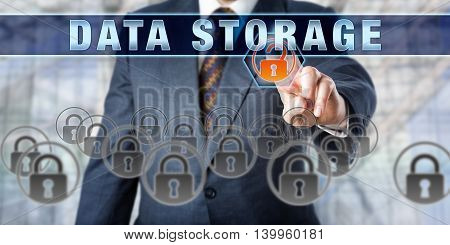Male corporate database manager pressing DATA STORAGE on an interactive control screen. Business metaphor. Information technology concept for computer storage data security and mass storage media.