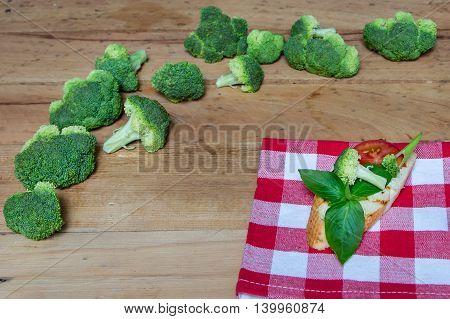 Sandwich with broccoli and tomato and basil. Broccoli. Green broccoli