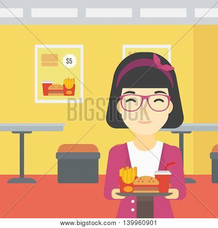 An asian woman holding tray full of junk food on a cafe background. Smiling woman in fast food restaurant. Woman having lunch in fast food restaurant. Vector flat design illustration. Square layout.