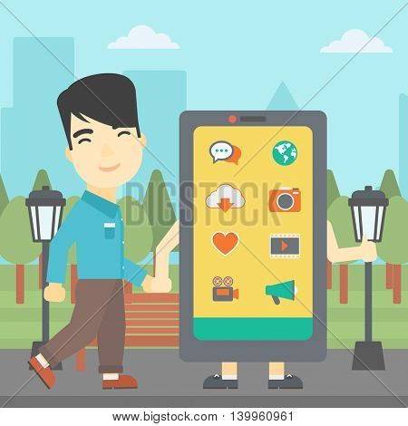 An asian young man walking with a big smartphone. Man and big smartphone in the park. Man holding the hand of smartphone. Smartphone addiction. Vector flat design illustration. Square layout.