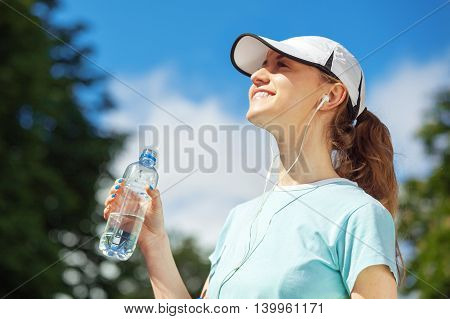 Portrait Of Happy Fitness Woman Drinking Water After Workout.