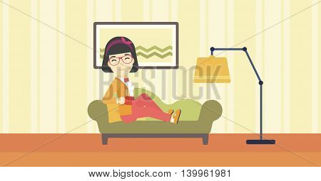 An asian young woman lying on sofa in living room and holding a cup of hot flavored tea. Vector flat design illustration. Horizontal layout.
