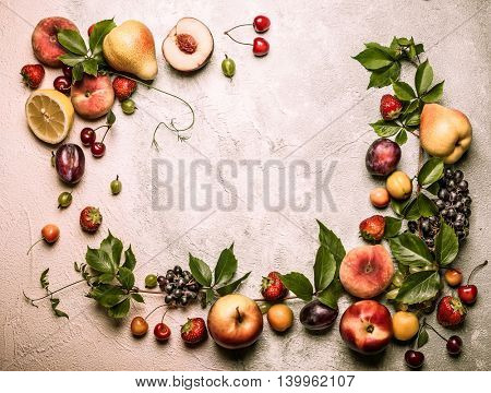 Still life of various fruits and berries . Top view. Vintage style