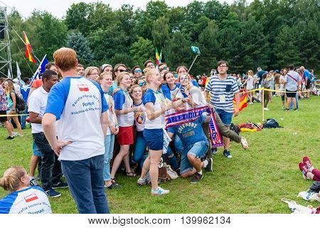 Poznan POLAND - JULY 24 2016: pilgrims taking selfie pictures during Days In Dioceses just before The World Youth Day in Krakow; WYD is a meeting of youth from all over the world